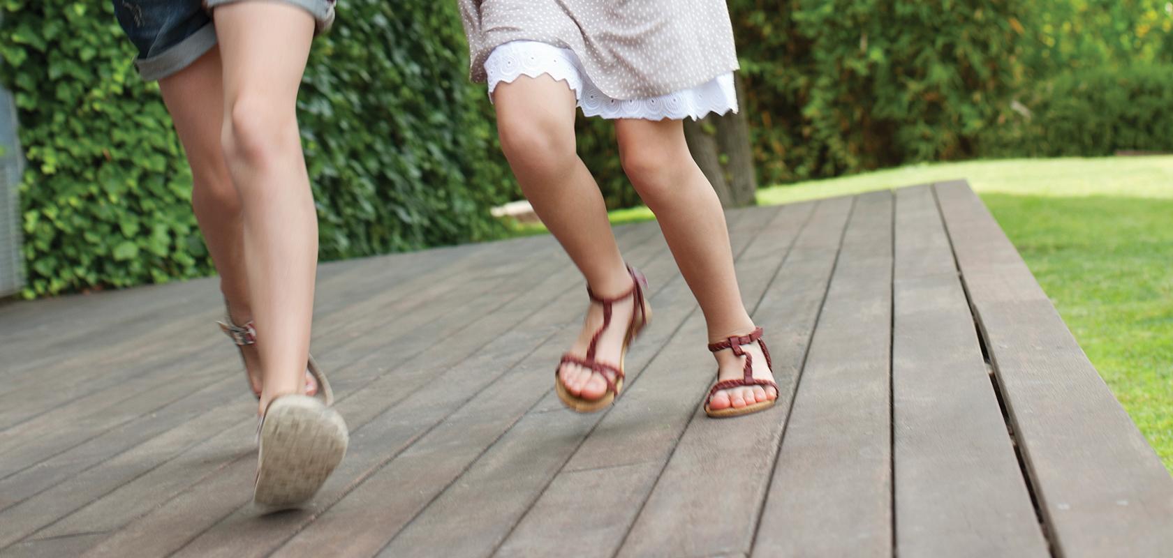 girls running on deck