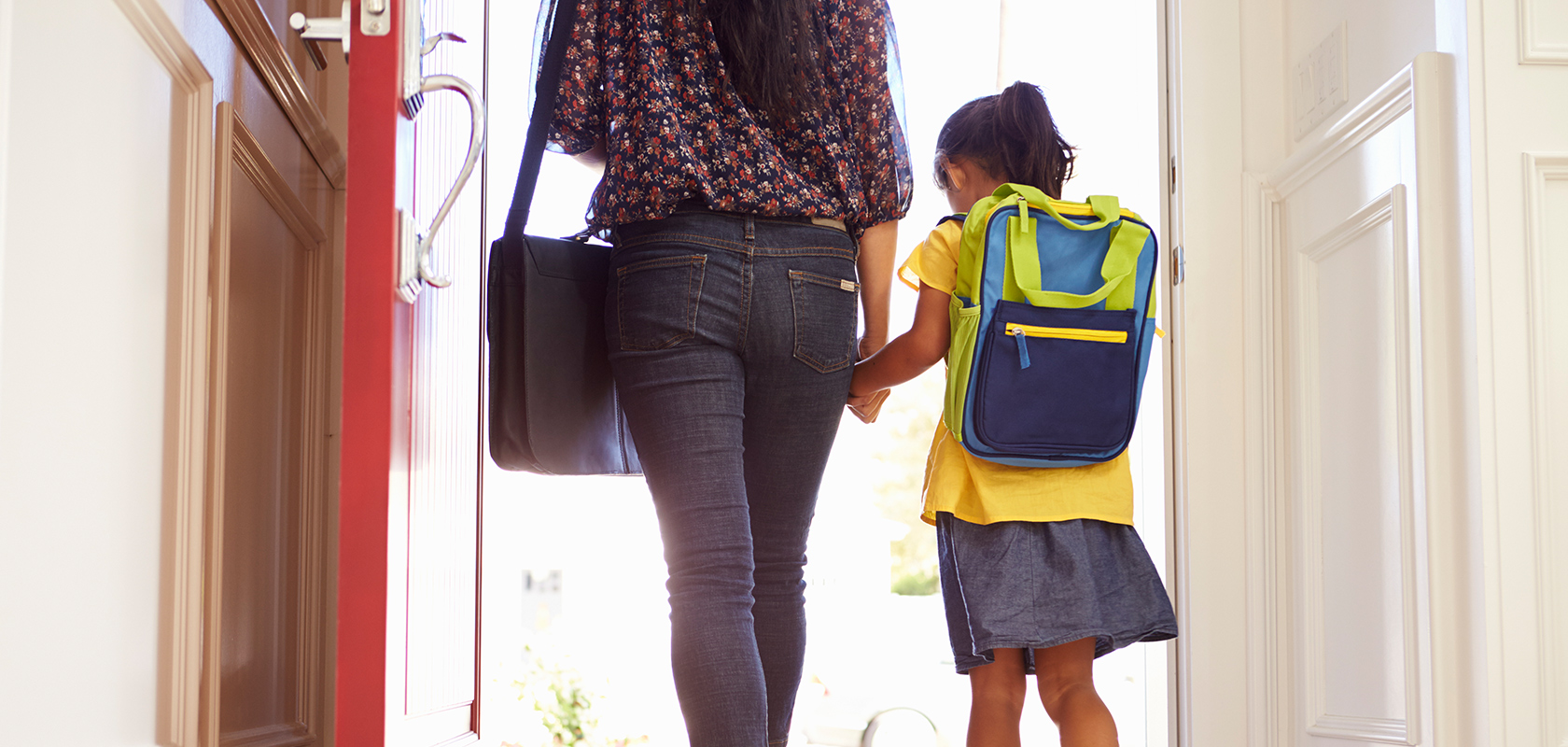 girl and mom going to school