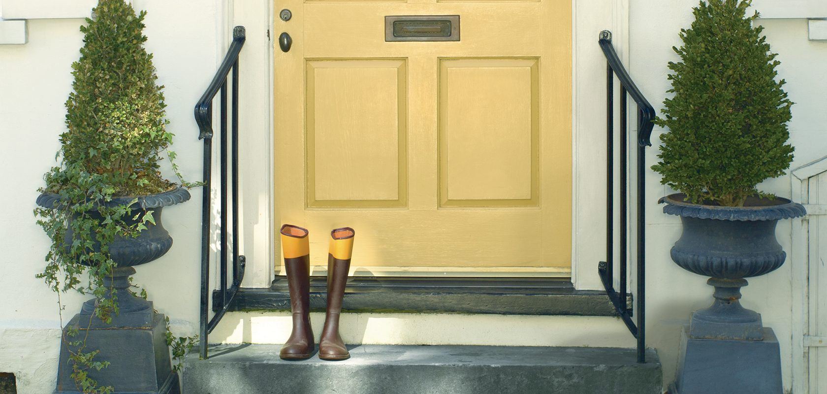 yellow front door with rubber boots