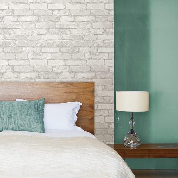 room scene with grey & white brick wallpaper