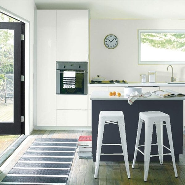 "Tip: ""Using shades of white for kitchen cabinets is timeless – keeps it fresh, bright and inviting."""