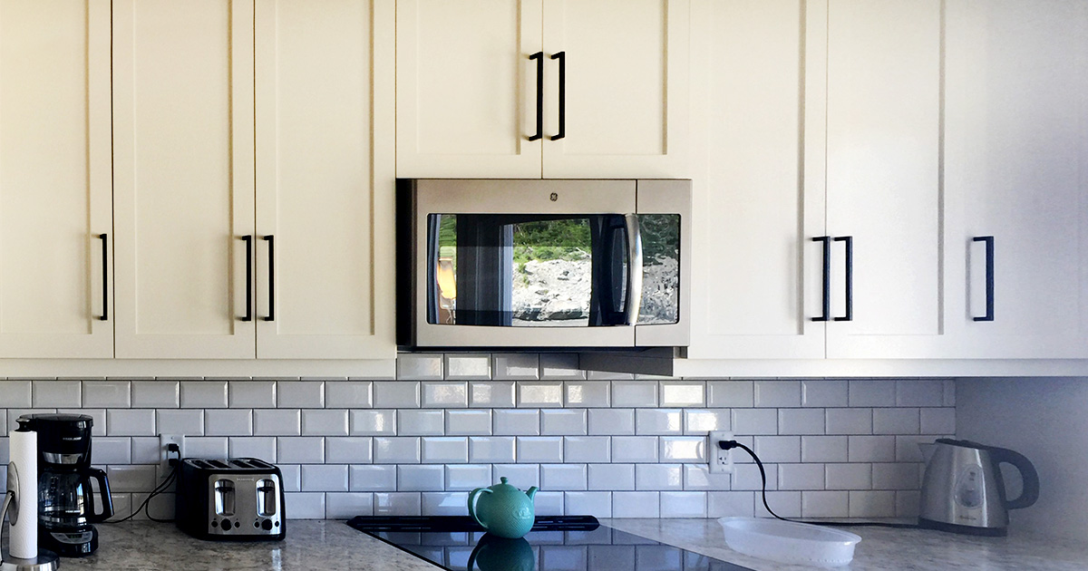 Cloud White Kitchen Cabinets with Subway Tile