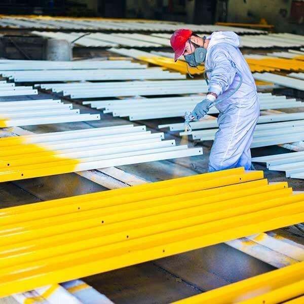man painting industrial